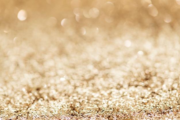Texture de fond de paillettes d'or scintillant