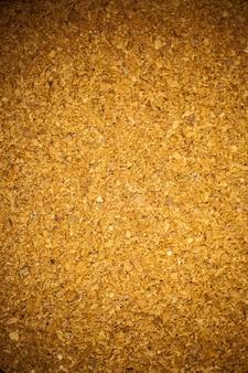 Texture de fond de panneau de liège brun.