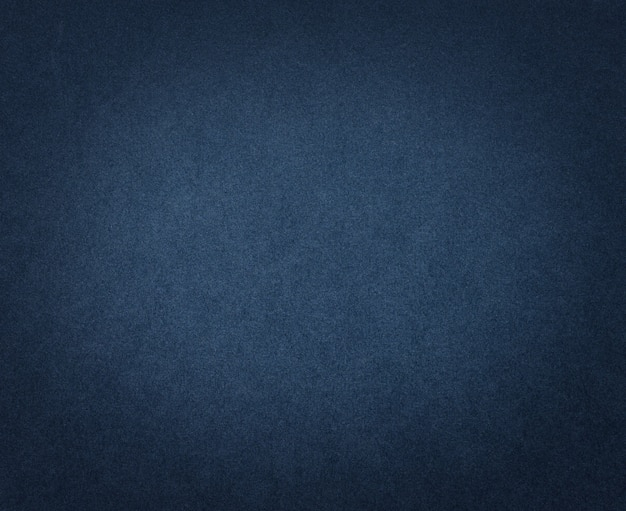 Texture ou fond de papier bleu foncé. carton bleu avec vignette sombre pour les œuvres d'art.