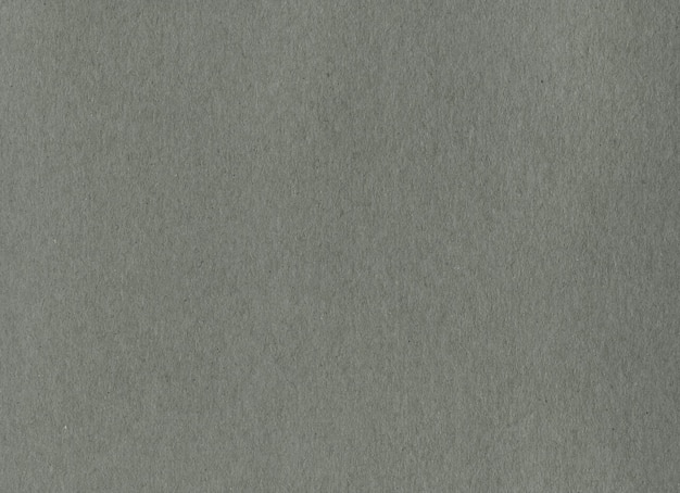 Texture de fond de papier carton kraft gris propre. carton vintage.
