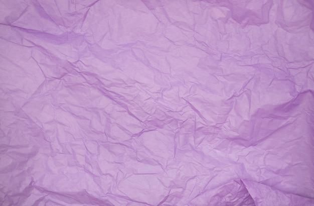 Texture de fond de papier de soie froissé de couleur pourpre texture de papier de soie froissé