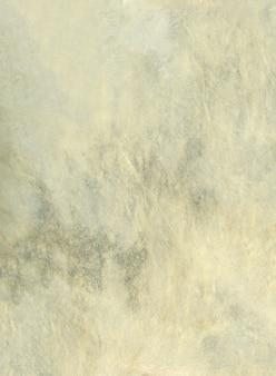 Texture de fond de peau de tambour en cuir beige. vue rapprochée