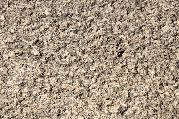 Texture de fond de pierre. fini buisson de pierre de granit antique