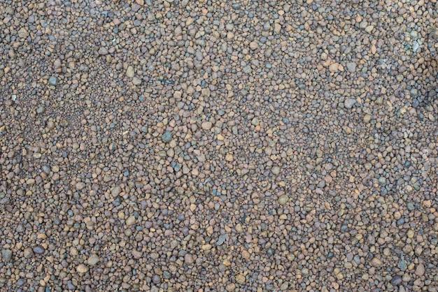 Texture de fond de pierre de petit gravier marron