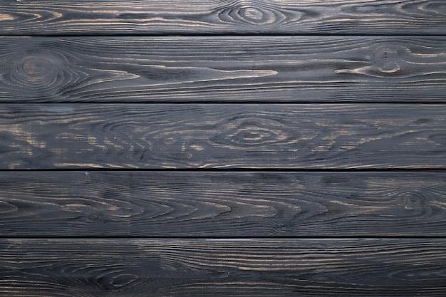Texture ou fond de planches de bois rustique vieux gris foncé.