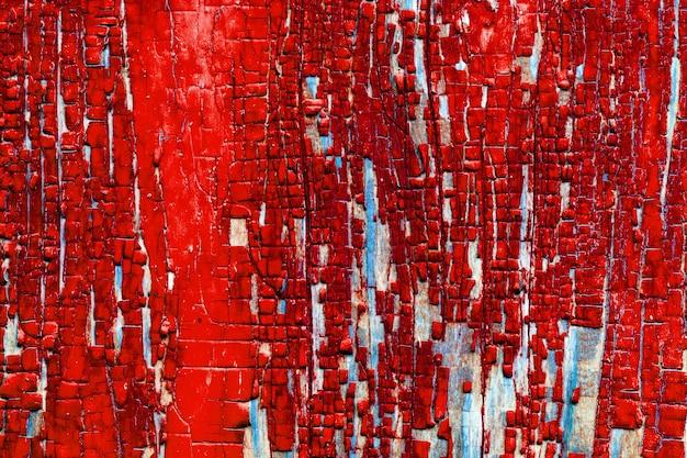 Texture de fond de planches de grange en bois avec des restes de peinture ancienne