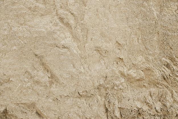 Texture de fond de roche de granit beige