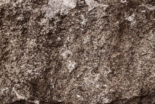Texture de fond de roche de granit brun