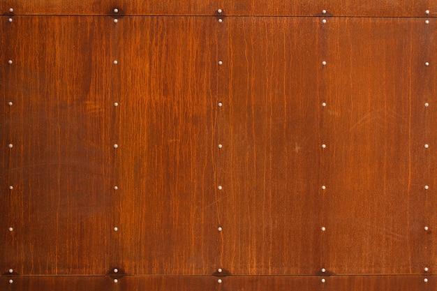 Texture ou fond rouillé abstrait en métal avec des rivets