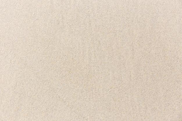 Texture de fond de sable de plage. plage de sable humide