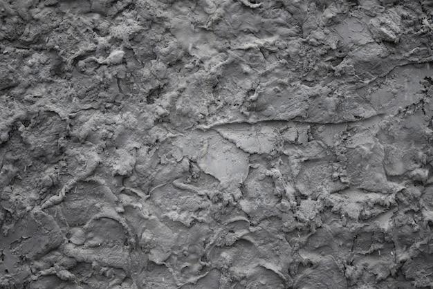 Texture de fond d'une surface rugueuse grise.