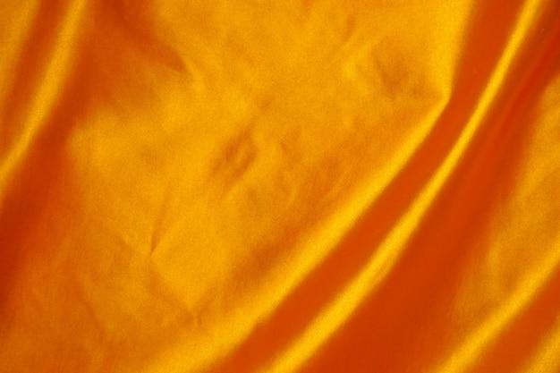 Texture de fond tissu or