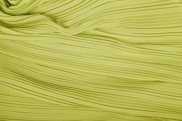 Texture de fond de tissu plissé. texture de tissu jupe plissée. modèle de texture de tissu plissé gros plan