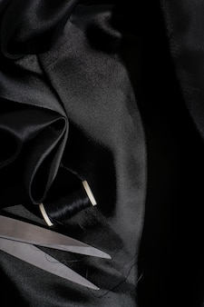 Texture de fond de tissu en soie noire