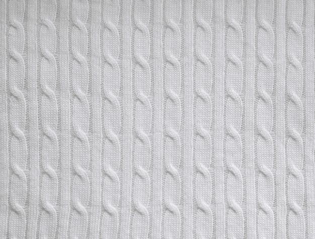 Texture de fond de tissu tricoté blanc