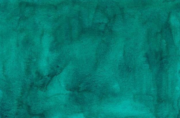 Texture de fond vert aquarelle mer profonde. aquarelle abstraite taches d'émeraude sur fond de papier