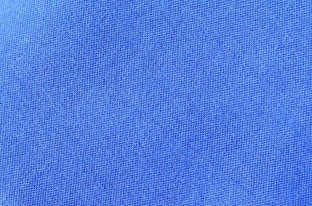 Texture et fond de vêtements de chemise de sport bleu