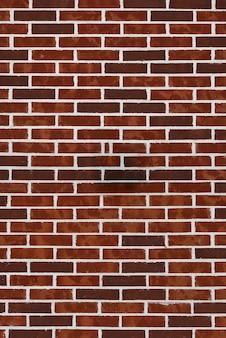 Texture de fond de vieilles briques et mortier victorien. mur de briques rouge foncé avec couture blanche.