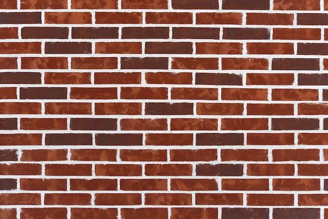 texture de fond de vieilles briques victoriennes et mortier. mur de briques rouge foncé avec couture blanche.