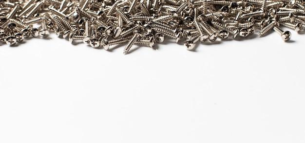 Texture de fond des vis métalliques. vis taraudeuses en acier.