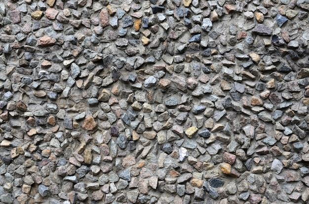 La texture d'un fort mur de pierre de nombreuses pierres bétonnées