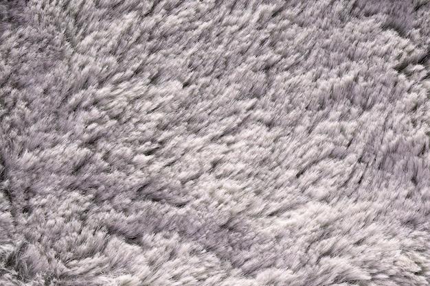 Texture de fourrure artificielle pour matériau gris moelleux gros plan