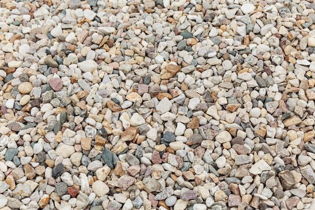 Texture galet. un gros tas de pierres. arrière-plan. espace pour le texte.