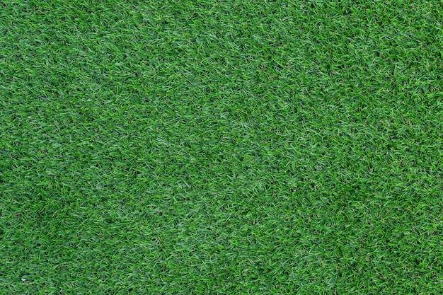 Texture de gazon artificiel vert pour le fond.