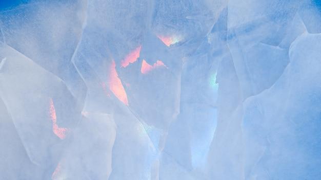 Texture de glace avec des reflets multicolores irisés colorés