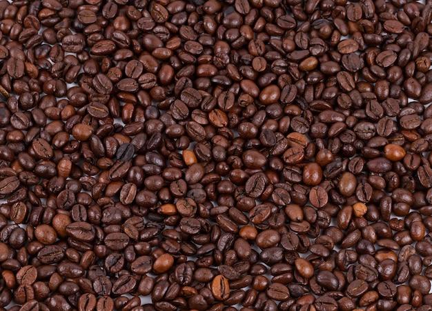 Texture de grains de café torréfiés utilisée comme arrière-plan