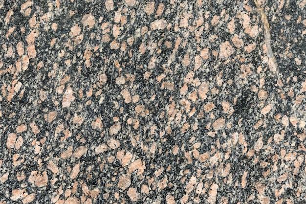 Texture de granit, fond de dalle de granit, pierre de marbre gris et rouge.