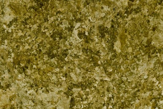 Texture de granit, surface de granit jaune, doré pour le fond