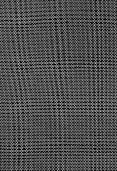 Texture de grille métallique sur fond noir