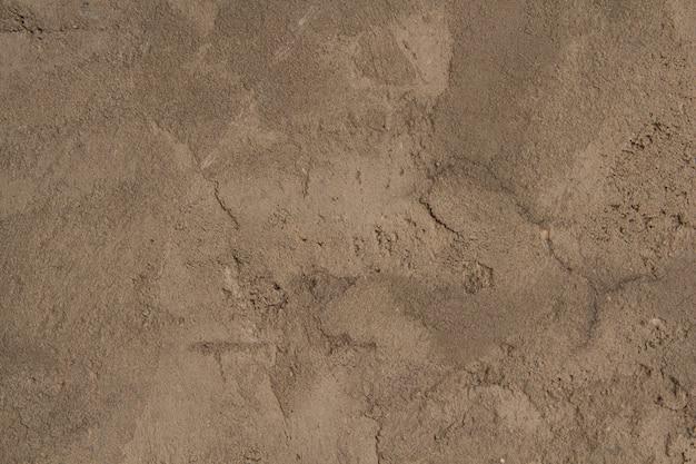 Texture grise de plâtre en béton. mur blanc-gris rugueux.