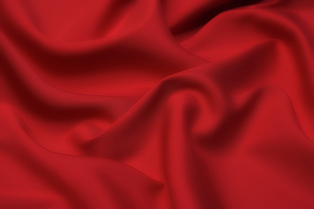 Texture de gros plan de tissu ou de tissu rouge ou orange naturel de la même couleur.
