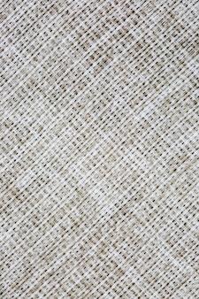 Texture de gros plan de tissu d'usine, entrelacement de fils.