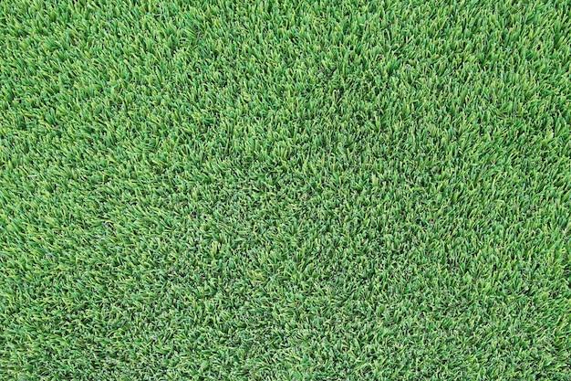 Texture d'herbe verte artificielle comme arrière-plan