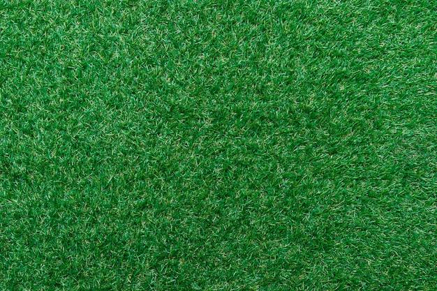 Texture d'herbe verte vue de dessus pelouse verte. golf ou football parfait, fond de terrain de football