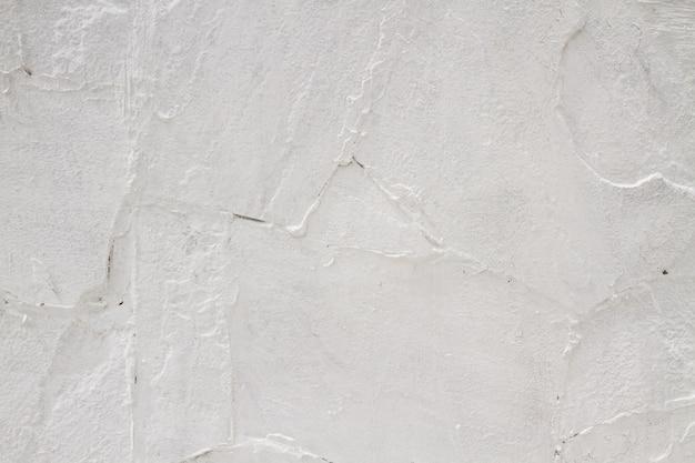 Texture inégale vieux mur blanchi à la chaux