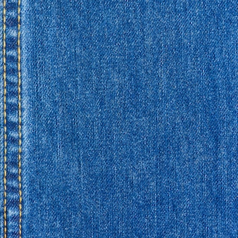 Texture de jeans bleu avec des coutures pour le fond