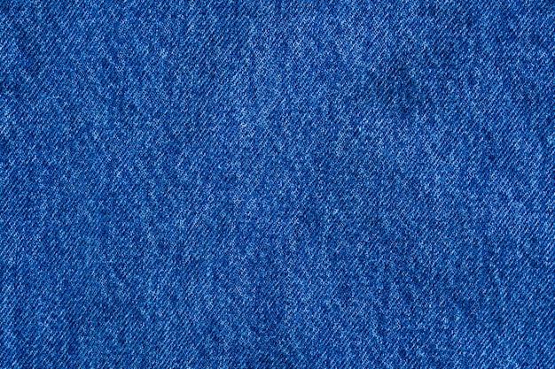 Texture de jeans bleu denim bouchent fond vue de dessus