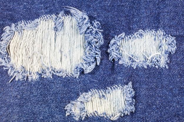 Texture de jeans en denim déchiré bleu