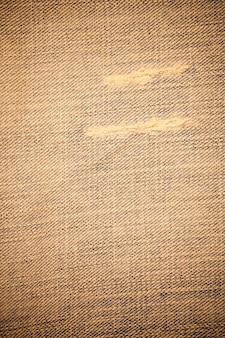 Texture de jeans en denim déchiré sale.