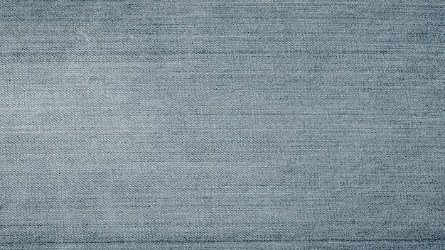 Texture de jeans en denim. texture de fond de denim pour la conception. texture de jeans bleu pour le fond.