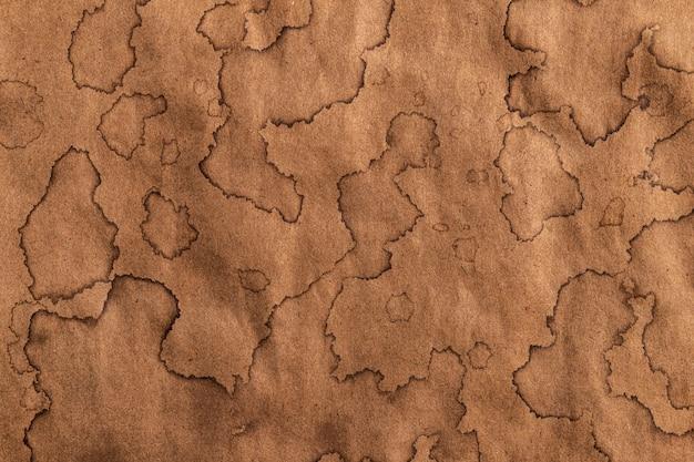 Texture kraft ancienne, fond de papier antique avec des taches de café brun