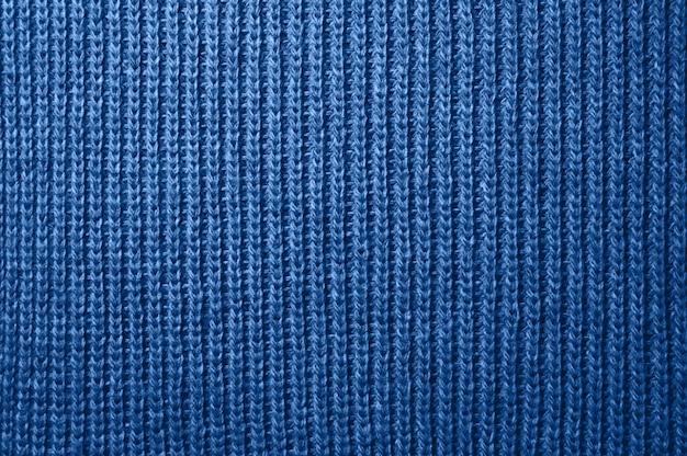 Texture de laine de tissu tricoté se bouchent