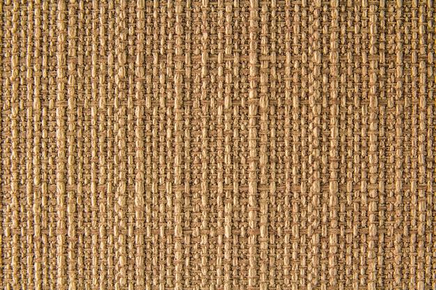 Texture de lin en tissu naturel pour la conception, un sac texturé. fond de toile marron. coton.