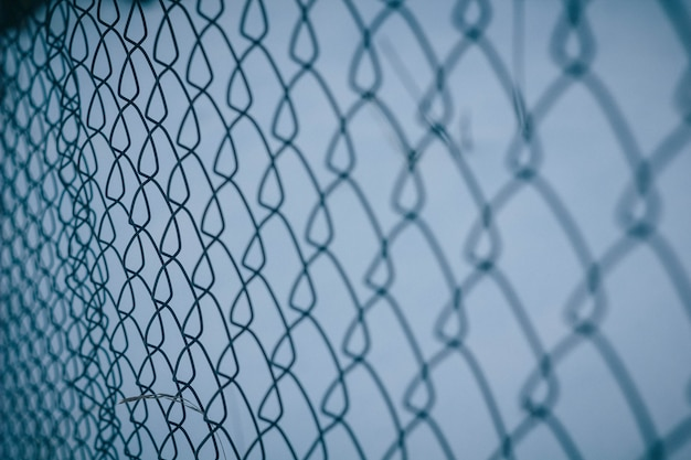 Texture maille filet. clôture de fond. clôture transparente. maillon de fer