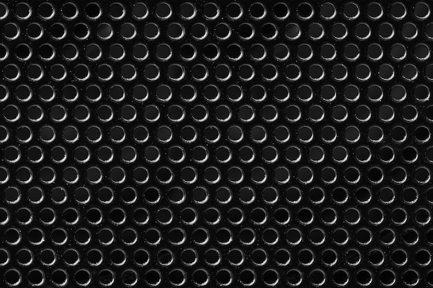 Texture maille noire métallique avec trous ronds