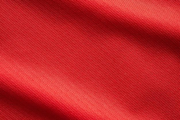 Texture de maillot de football de tissu de vêtements de sport rouge bouchent
